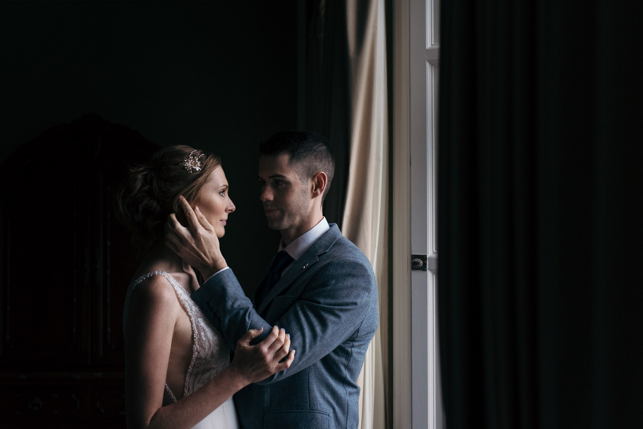 A tender moment between bride and groom